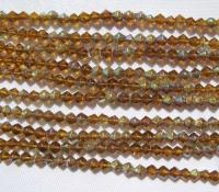 4 mm rombo formos stikl. šviesiai rudų su AB danga karoliukų juosta